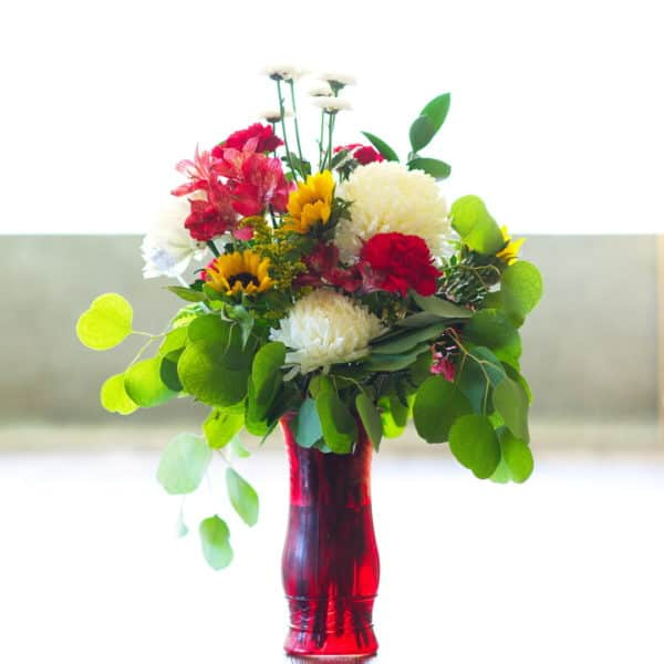 Red, Yellow, and White Flowers in a Red Vase